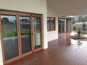 Doors fold back to make an open in door/out door space, the family room and deck form one large entertaining area